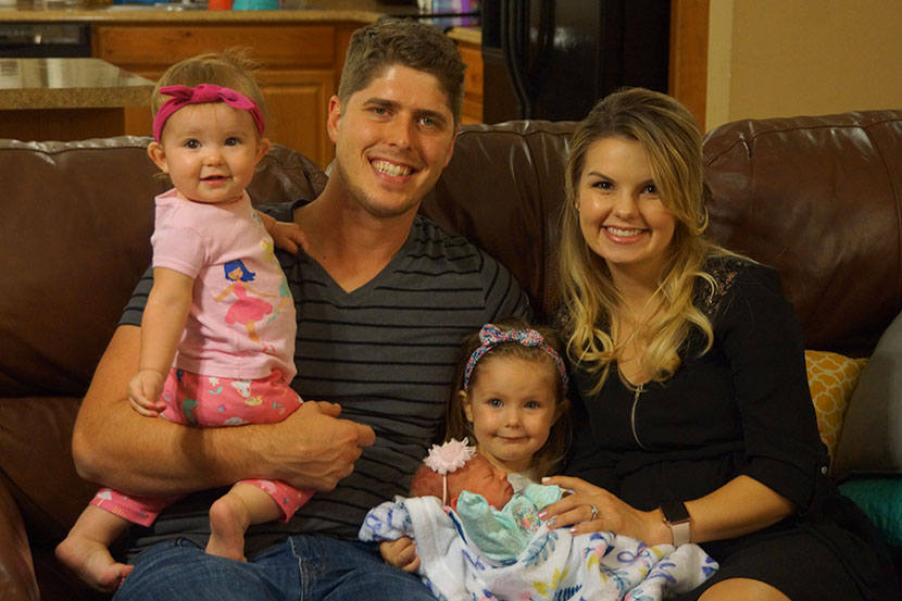 John and Alyssa Webster with their three daughters.